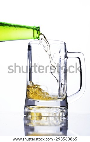Pouring beer into Beer glass for drink beer concept - stock photo