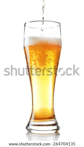 Pouring beer into glass isolated on white - stock photo
