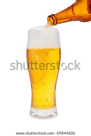 Pouring Beer isolated on a white background - stock photo