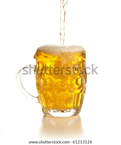 pouring beer on a glass - stock photo