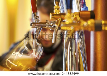 Pouring beer to a glass - stock photo