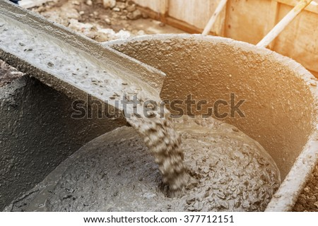 Pouring cement during for construction with with vintage tone. - stock photo