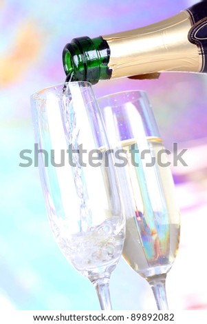 Pouring champagne in glasses, closeup - stock photo