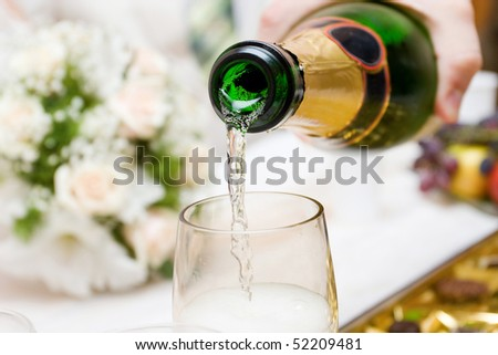 pouring champagne to the glasses - stock photo