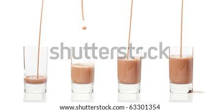 Pouring chocolate milk in a glass isolated on white background - stock photo