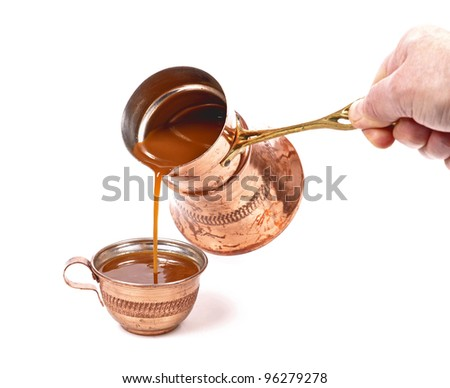 pouring coffee on a cup,copper cups , on a white background - stock photo