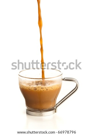 pouring coffee on a cup on a white background - stock photo