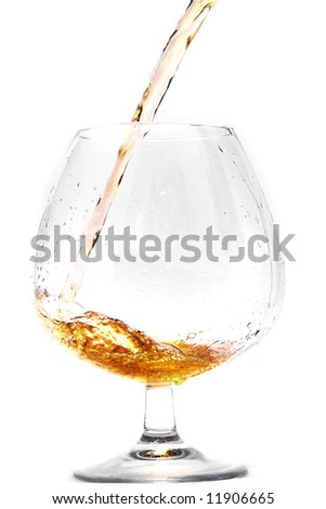 Pouring cognac into a Glass.