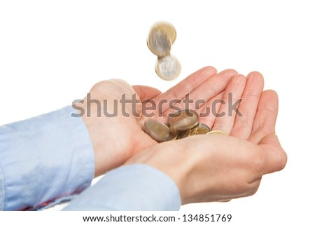 Pouring coins in woman's hands: white background - stock photo