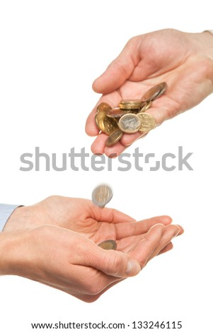 Pouring coins into hands isolated on white background