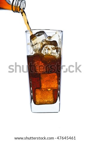 pouring cola in glass - stock photo