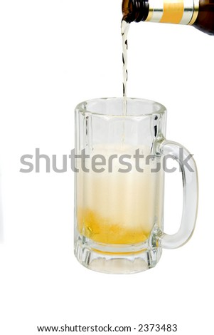 Pouring foamy Ice cold beer isolated on a white background