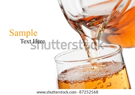 pouring fresh apple juice isolated on a white background - stock photo