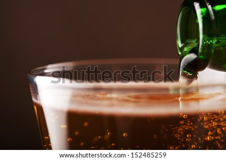 pouring fresh beer into glass  - stock photo