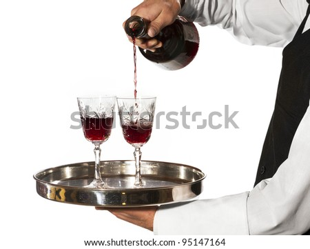 Pouring glasses of wine - stock photo