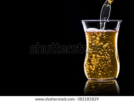 Pouring green tea in a glass