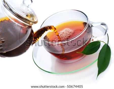 Pouring Healthy Tea over white - stock photo