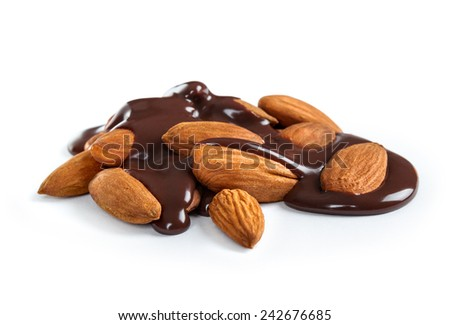 Pouring hot melted chocolate and almond nuts - stock photo