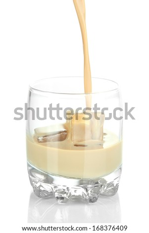 Pouring liquor in glass isolated on white - stock photo