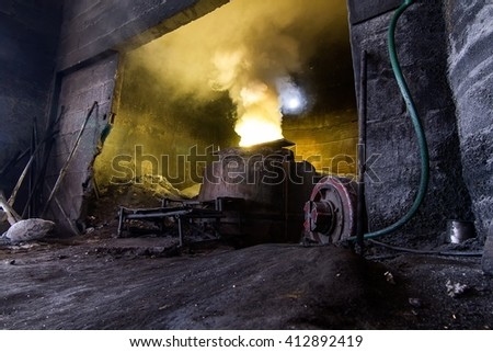 Pouring molten steel in the foundry - stock photo