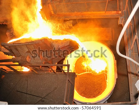 pouring molten steel in transportation device - stock photo