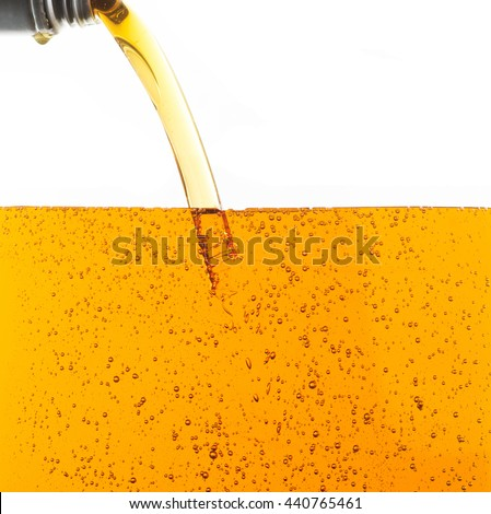 Pouring motor oil on white background - stock photo