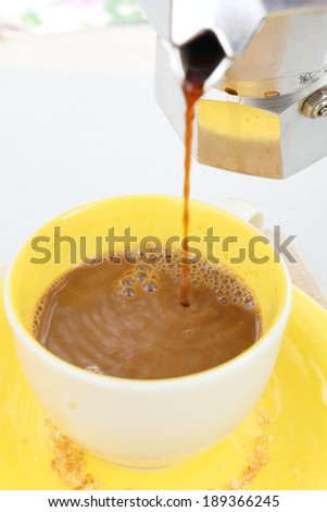 Pouring of coffee in italian coffee maker - stock photo