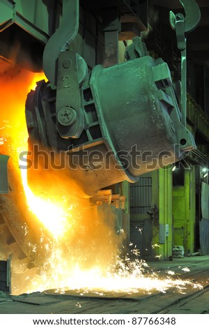 Pouring of liquid metal - stock photo