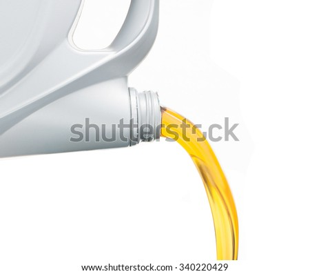 Pouring oil lubricant motor car from bottle on isolated white background - stock photo