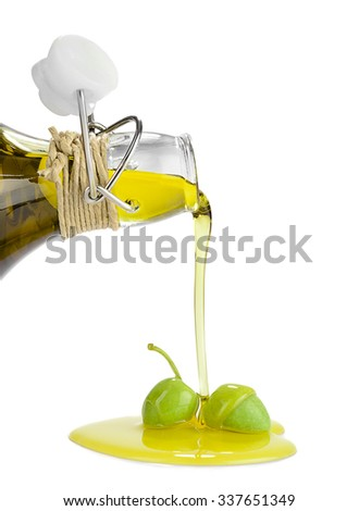 Pouring olive oil on green olive isolated on white background. - stock photo