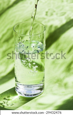 pouring pure water on green