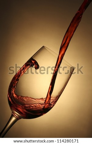 Pouring red wine - stock photo