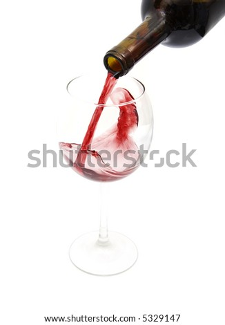 pouring red wine from a bottle isolated against white background