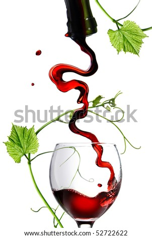 Pouring red wine in glass with rod isolated on white - stock photo
