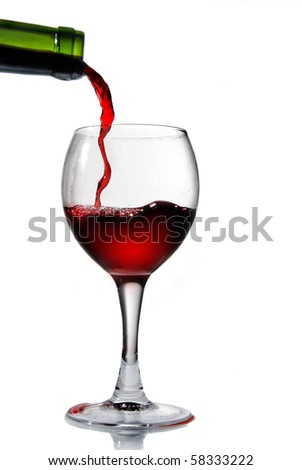 Pouring red wine in goblet isolated on white - stock photo