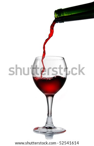 Pouring red wine into the goblet - stock photo