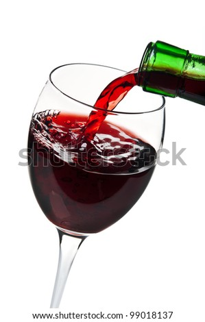 pouring red wine isolated on a white background
