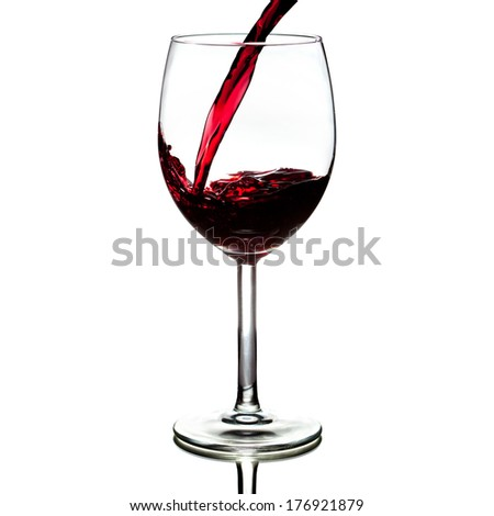 pouring red wine isolated on white background