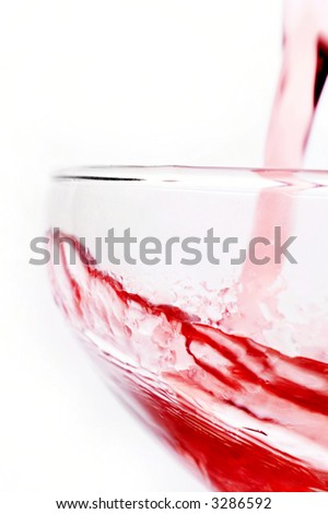 pouring red wine / splash close up with white background
