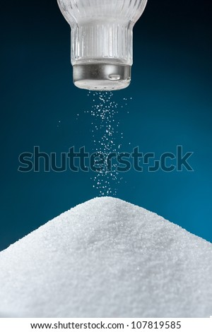 Pouring salt from a salt pot - stock photo