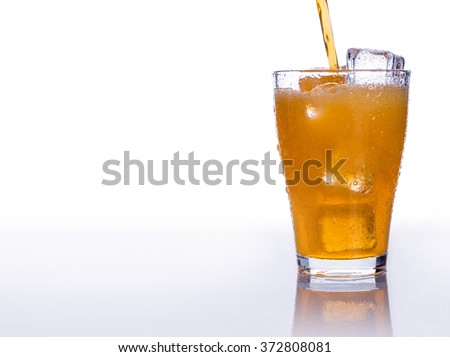 Pouring soft drink in a glass with ice on an isolated white background - stock photo