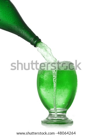 Pouring St. Patrick's Day green beer - stock photo