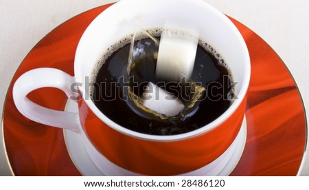 pouring sugar into a cup of coffee - stock photo