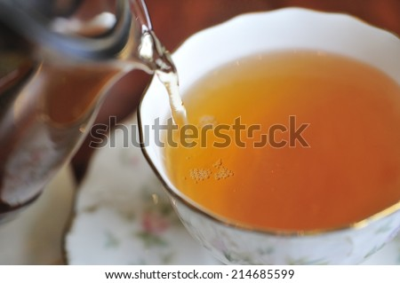 Pouring tea - stock photo