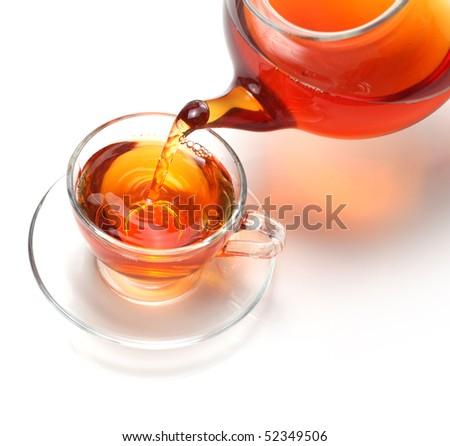 pouring tea to a teacup - stock photo