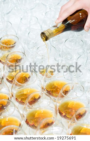 pouring the brandy, selective focus - stock photo