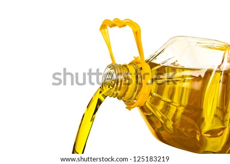 pouring the oil isolated on white background - stock photo