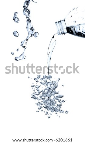 pouring water from a bottle isolated - stock photo