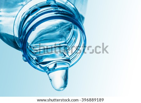 Pouring water from a plastic bottle - stock photo