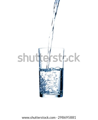 Pouring water from bottle into glass - stock photo